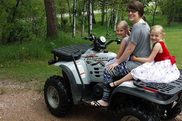 on a 4 wheeler with my nieces